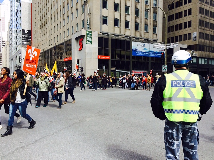 Thousands of demonstrators have taken to the streets of Montreal and elsewhere in the province to mark International Workers Day on May 1, 2015.