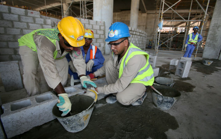 Migrant labourers work on a construction site on October 3, 2013 in Doha in Qatar. Qatar, the 2022 World Cup host has faced criticism over its treatment of migrant workers in the construction of stadiums and other facilities.
