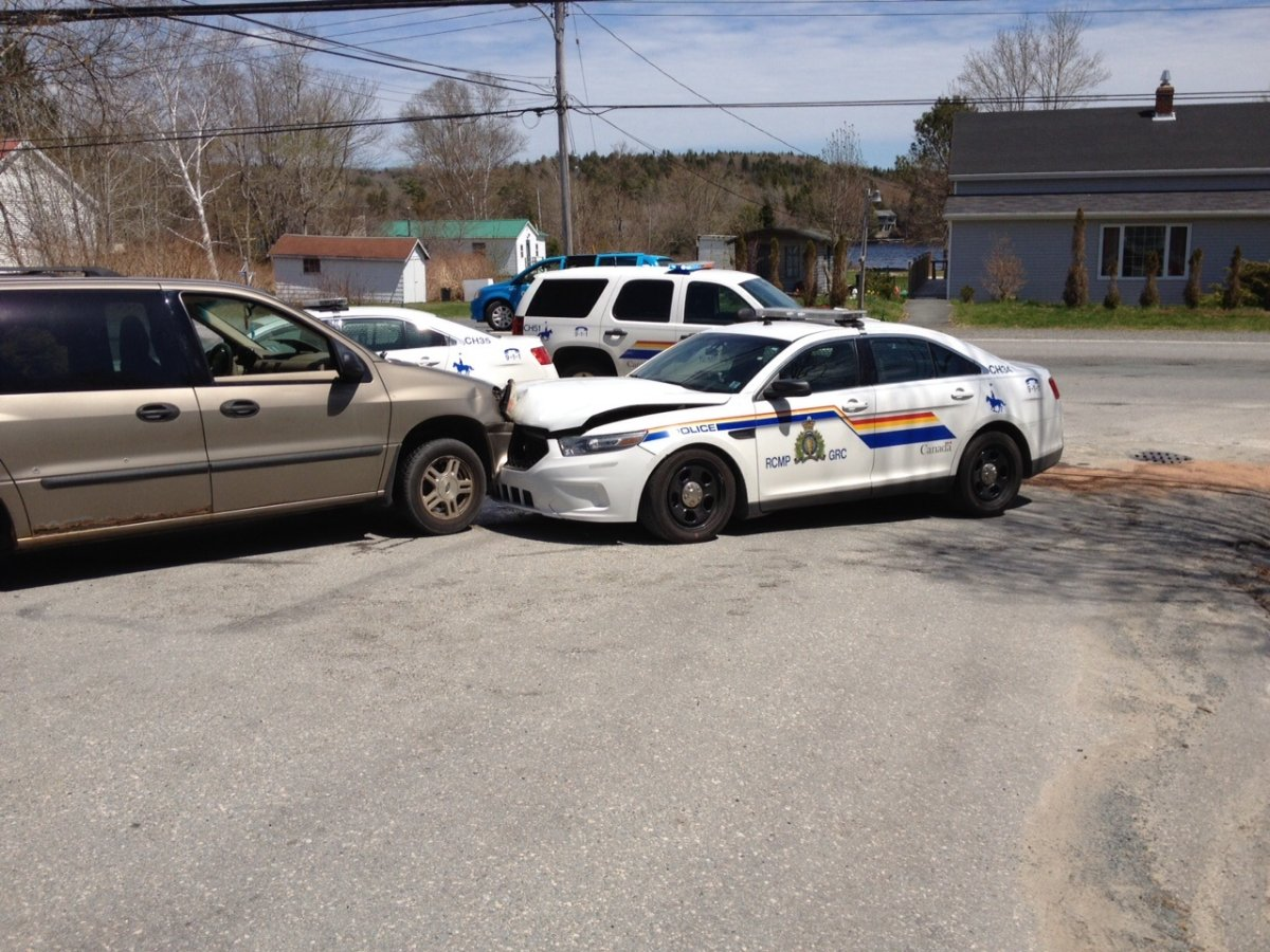Three people have been charged after a van being pursued by police spun out of control and collided with two cruisers in Lake Echo on Thursday.
