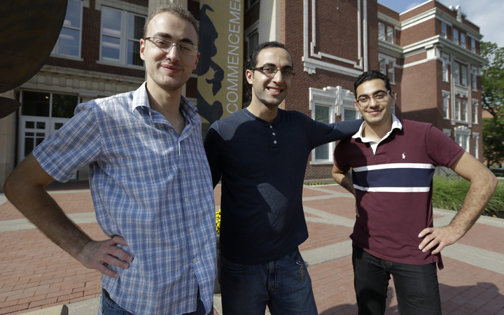 Syrian brothers Mohammad Kayali, left, Ebrahim Kayali, right and Molham Kayali, center, pose for a photograph on the Emporia State University campus in Emporia, Kan., Wednesday, May 6, 2015.