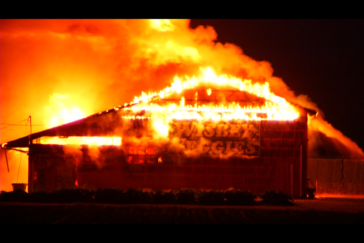 The barn was completely engulfed in flames.