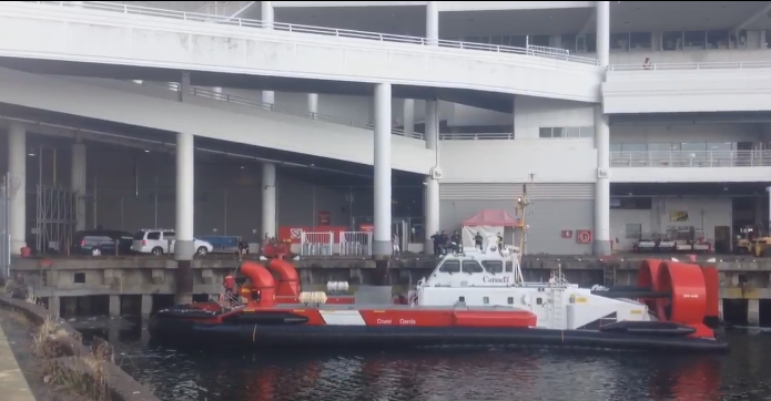Coast Guard assist Vancouver Police and Transit Police in extracting a man who jumped into the ocean and under Canada Place to escape police after robbing a Tim Hortons on June 27, 2015.