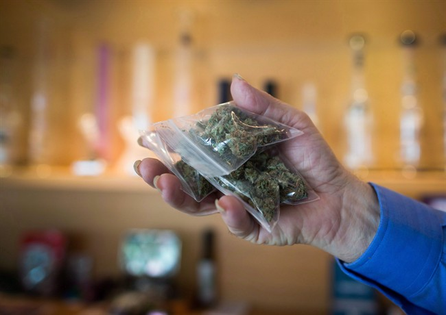 A bag of marijuana is held up at a medical marijuana dispensary in Vancouver.