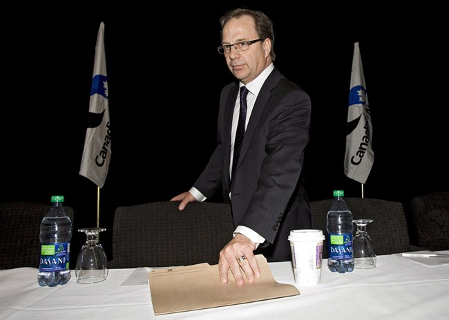 Steve Laut, president of Canadian Natural Resources Ltd., prepares to address the company's annual meeting in Calgary, Thursday, May 3, 2012.