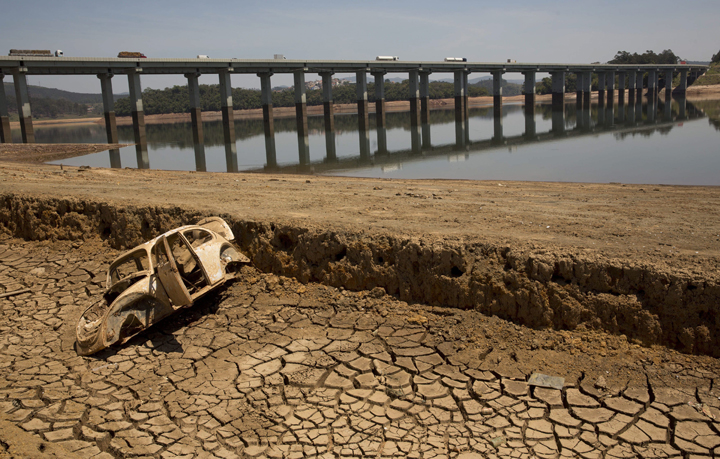 The frame of a car sits on the cracked earth at the bottom of the Atibainha dam, part of the Cantareira System responsible for providing water to the Sao Paulo metropolitan area, in Nazare Paulista, Brazil.