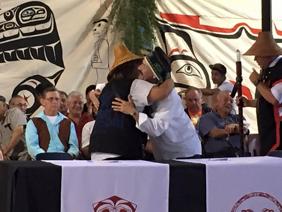 Lorena White, Heiltsuk Tribal Council member, and Harold Yeltatzie, Old Massett Village Council member, embrace after signing the peace treaty