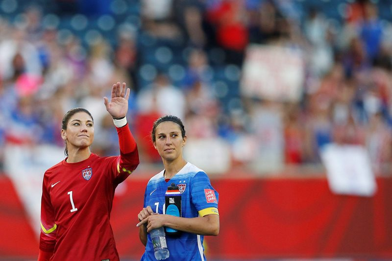 United States goalkeeper Hope Solo (1) waves to the crowd with teammate Carli Lloyd (10) after their draw against Sweden in FIFA Women's World Cup soccer action in Winnipeg on Friday, June 12, 2015.