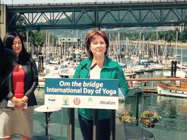 Christy Clark making the announcement about Om the Bridge.