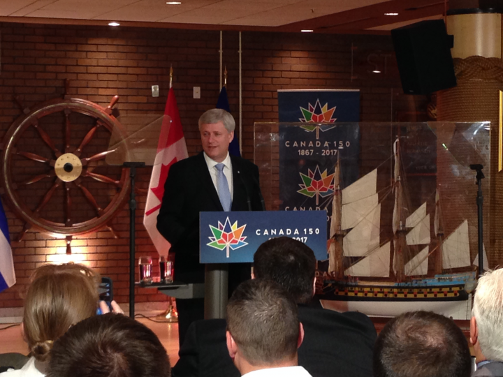 Prime Minister Stephen Harper talks hockey in Quebec City on Thursday, June 25, 2015.