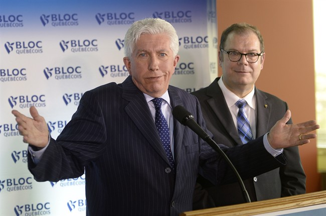 Bloc Quebecois Leader Gilles Duceppe gestures at a news conference in Montreal on Wednesday, June 10, 2015 as party president Mario Beaulieu looks on.