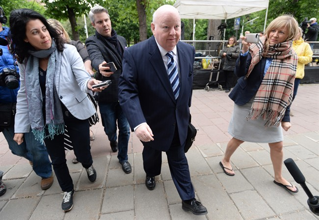 Suspended Senator Mike Duffy heads to court in Ottawa on Monday, June 1, 2015.