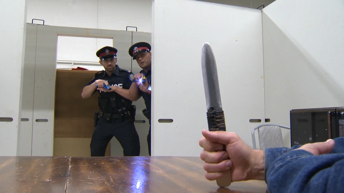 In a training scenario at Toronto Police College, officers talk down a suicidal man. They display their Tasers, but don't fire them.