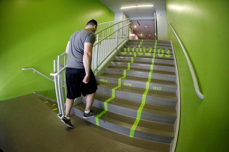 In this file photo a Utah Valley University student walks up the stairs to the gym.