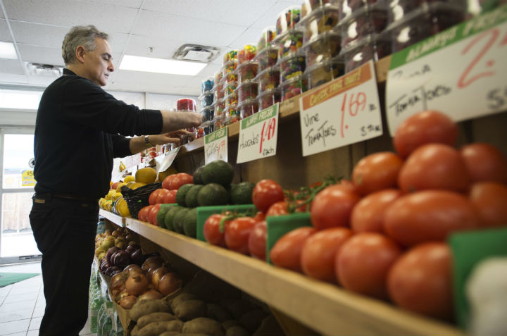 Azmi Farah, a Hasty Market owner, organizes produce at his Hasty Market location in Toronto on Wednesday, April 22, 2015.  (File photo).