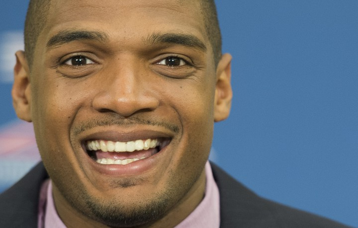 Newly acquired Montreal Alouettes' player Michael Sam smiles during a news conference in Montreal, Tuesday, May 26, 2015.