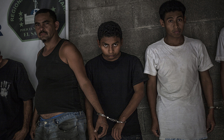 Suspected members of the 18th Street gang stand handcuffed in pairs at a police station in Panchimalco, near San Salvador, El Salvador on May 28, 2015.