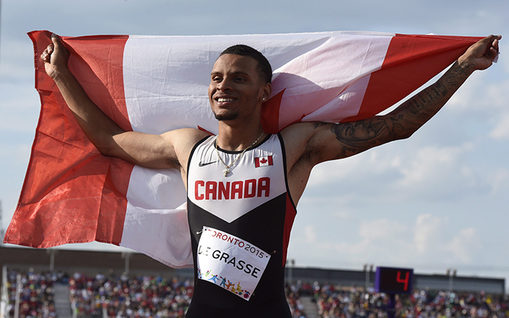 Andre De Grasse, of Canada, smiles after winning gold in the 200m final during the athletics competition at the 2015 Pan Am Games in Toronto on Friday, July 24, 2015.