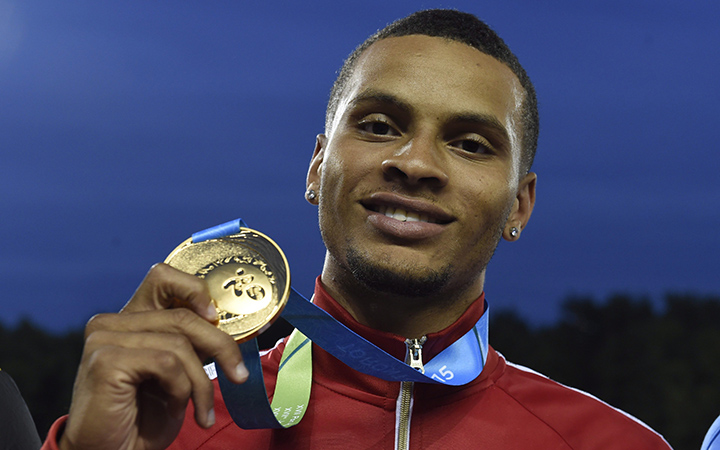 Andre De Grasse, of Canada, holds his gold medal after winning the men's 200m final during the athletics competition at the 2015 Pan Am Games in Toronto on Friday, July 24, 2015.