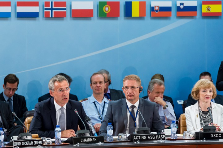 NATO Secretary General Jens Stoltenberg, left, talks during a North Atlantic Council Meeting at NATO headquarters in Brussels on Tuesday July 28, 2015. For just the fifth time in its 66-year history, NATO ambassadors met in emergency session Tuesday to gauge the threat the Islamic State extremist group poses to Turkey, and the debated actions Turkish authorities are taking in response.