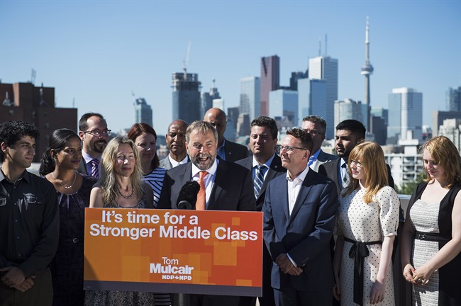 NDP leader Tom Mulcair, seen here campaigning in Ontario, has touted his plan to create a federal minimum wage of $15 per hour.