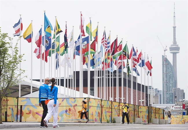 Flags of the participating countries fly in the athletes' village as the CN Tower stands in the background at the 2015 Pan American Games in Toronto on July 9, 2015.