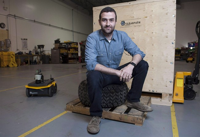 Clearpath Robotics CEO Matt Rendall poses for a portrait at the Clearpath Robotics warehouse in Kitchener, Ont., on Thursday, Dec. 18, 2014. Canadian robot manufacturer Clearpath Robotics is rolling into Silicon Valley with a new office.
