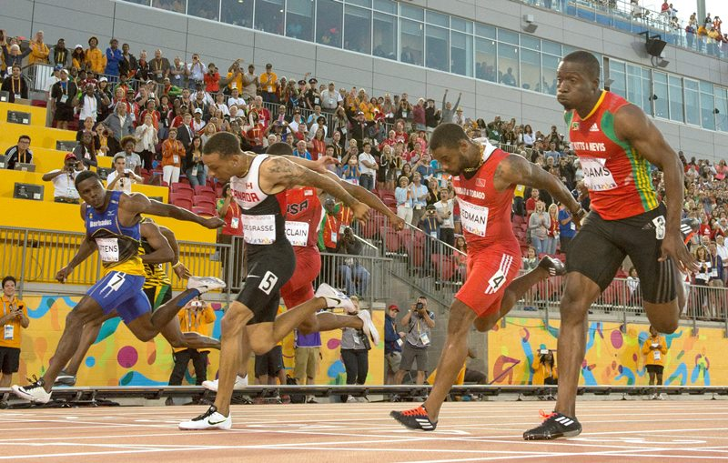 Andre De Grasse, of Canada, (5) wins gold medal in the men's 100m final during the athletics competition at the 2015 Pan Am Games in Toronto on Wednesday, July 22, 2015.