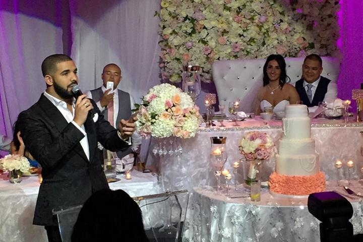 Drake toasts the newlyweds on July 16, 2015.