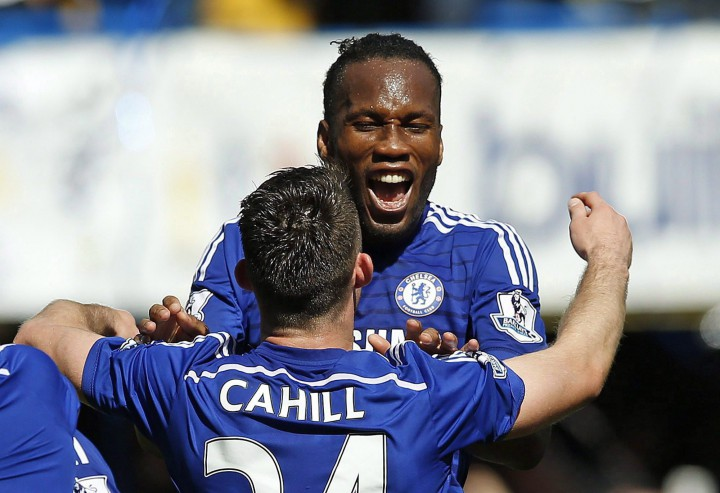 Chelsea's Didier Drogba embraces Gary Cahill as they celebrate after the English Premier League soccer match between Chelsea and Crystal Palace at Stamford Bridge stadium in London on May 3, 2015.