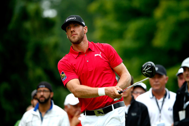 Graham DeLaet tees off on the third hole during the final round of the RBC Canadian Open at the Royal Montreal Golf Club on July 27, 2014 in Montreal, Quebec.