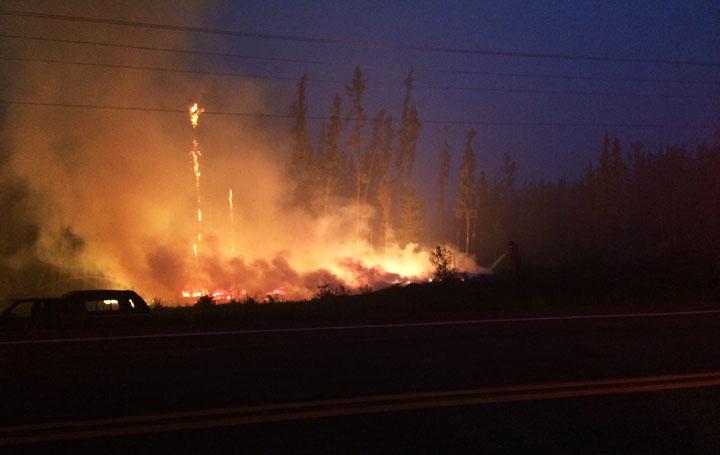 Saskatoon Fire Department send firefighters and equipment up north as wildfires encroach on Saskatchewan community.
