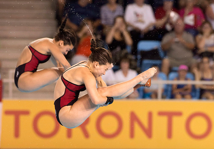 Canada's Meaghan Benfeito, back, and Roseline Filion compete in the women's 10-metre synchronized platform diving final at the 2015 Pan Am Games in Toronto on Monday, July 13, 2015.