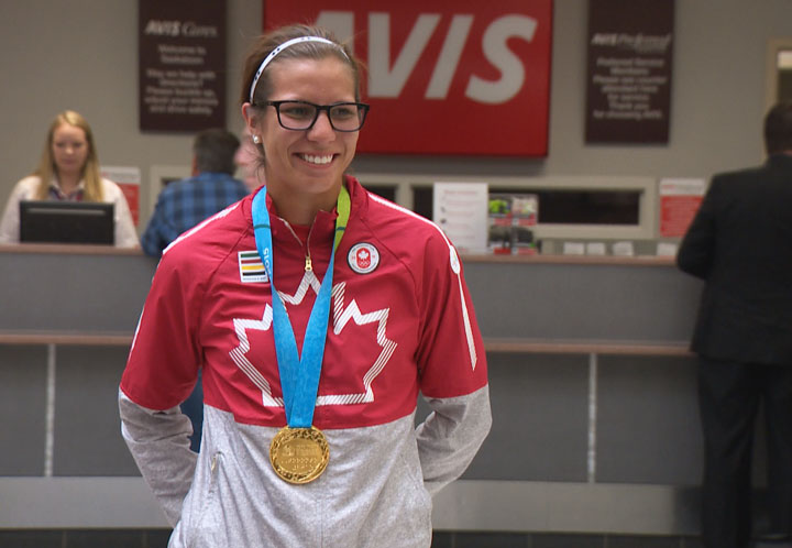 Saskatchewan's Megan Gurski arrives home Monday after winning a gold medal with the Canadian women's softball team at the 2015 Pan Am Games.