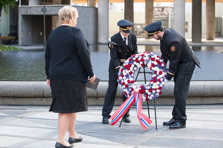 Norway's Prime Minister Erna Solberg attend a wreath laying ceremony near the government building damage by the bomb attack four years ago in Oslo, on July 22, 2015.
