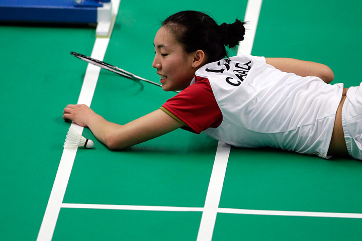 Canada's Michelle Li looks at the shuttlecock after missing a return to Canada's Rachel Honderich during the women's singles final in badminton competition at the Pan Am Games in Markham, Ontario on Thursday, July 16, 2015.