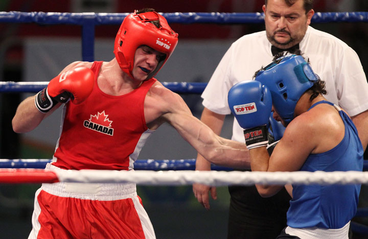 Canada's Brody Blair (red) defeated Jose Bernal of El Salvador in men's 75 kg. boxing action action at the 2011 Pan American Games in Guadalajara, Mexico on Sunday, Oct. 23, 2011.
