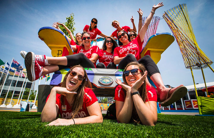 The Canadian women's water polo team poses for a picture on a giant chair inside the Pan American Games athletes village in Toronto, Friday July 3, 2015.