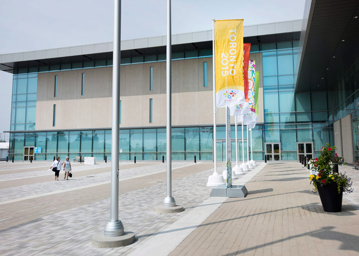 People walk outside of the women's water polo venue during the tip off of competition for the Pan Am Toronto 2015 at the Atos Markham Centre in Markham, Ont. on Tuesday, July 7, 2015.