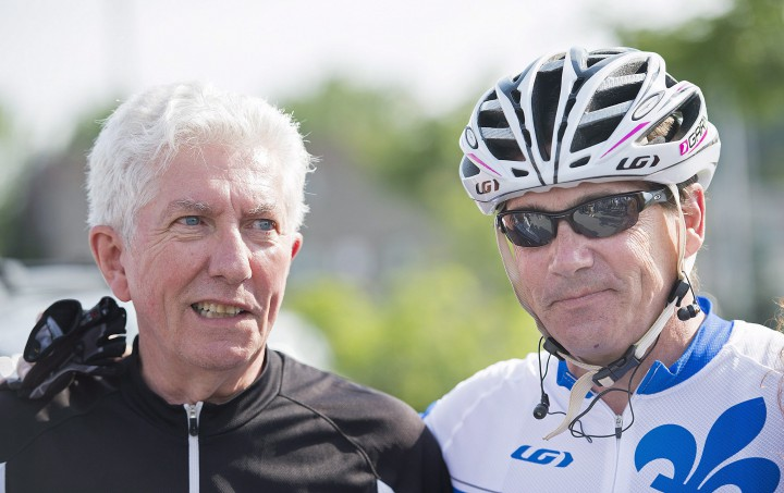 Bloc Québecois leader Gilles Duceppe, right, talks with Parti Québecois leader Pierre Karl Péladeau prior to setting off on their bicycles in Repentigny, Que., Wednesday, July 29, 2015, for a tour of some regions of Quebec.