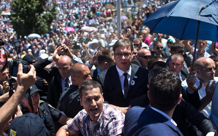 Aleksandar Vucic, Serbia's prime minister, center, is seen during a scuffle at the Potocari memorial complex near Srebrenica, 150 kilometers northeast of Sarajevo, Bosnia and Herzegovina, Saturday, July 11, 2015.