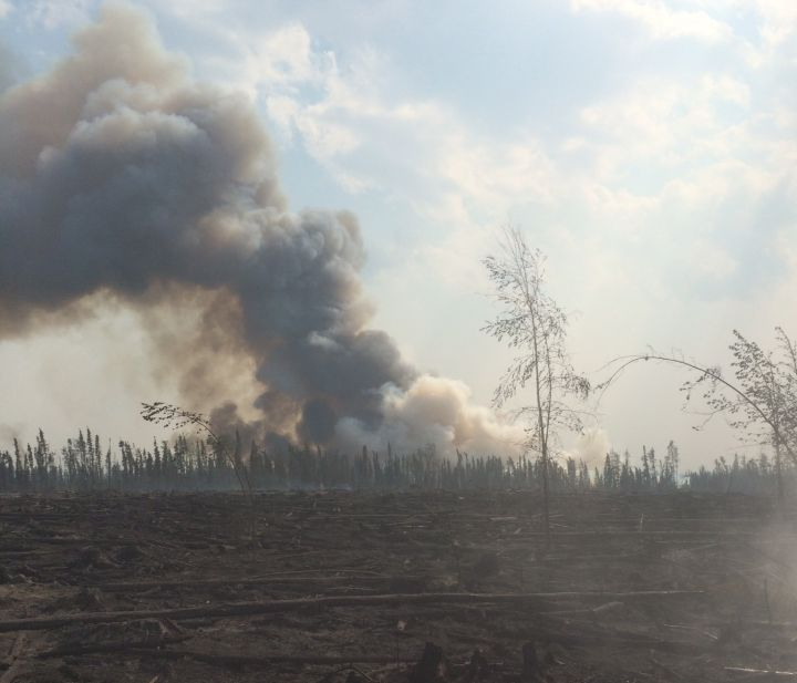 FILE: A wildfire burns in the Slave Lake area Tuesday, June 30, 2015.