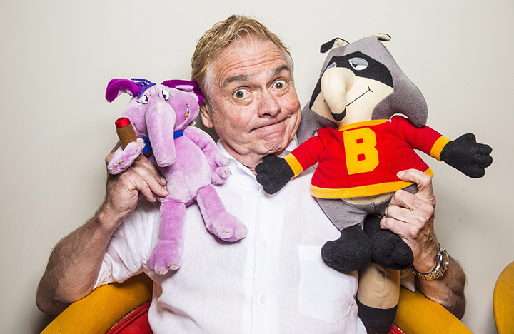 Kevin Gillis, creator of 'The Raccoons', pictured on July 2, 2015 with plush characters from the show.