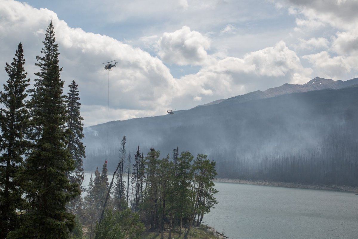 Two helicopters monitoring wildfire conditions.