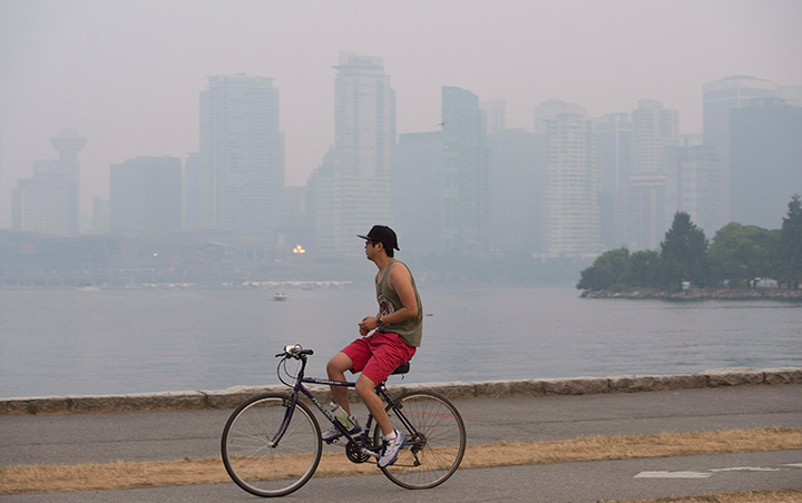 Smoke from wildfires in the interior of British Columbia blanket downtown Vancouver, B.C. Sunday, July 5 2015.