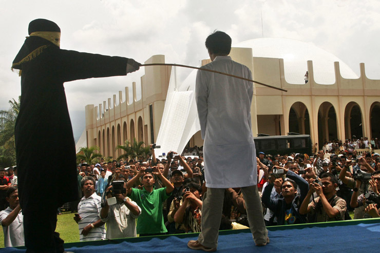 A man is publicly flogged in Indonesia in 2011.