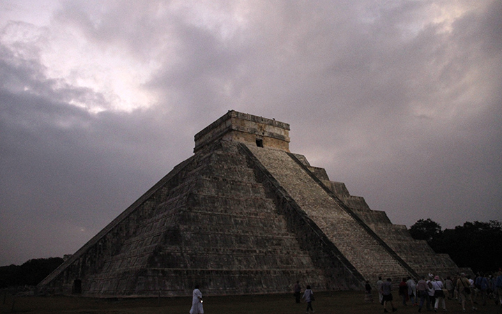 People gather in front of the Kukulkan temple in Chichen Itza, Mexico.
