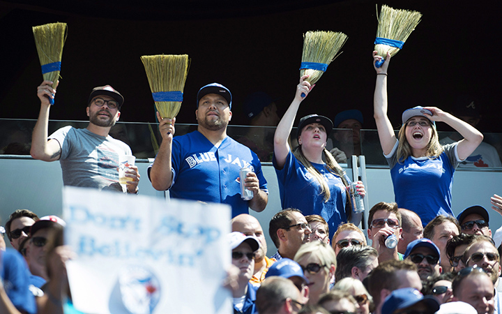 Fans celebrate the Toronto Blue Jays' series sweep of the Oakland Athletics during MLB baseball action in Toronto on Thursday, August 13, 2015.