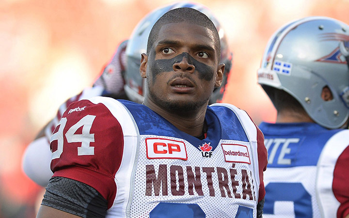 Montreal Alouettes' Michael Sam and teammates warm up for a Canadian Football League game against the Ottawa Redblacks in Ottawa, Ontario on Aug. 7, 2014.