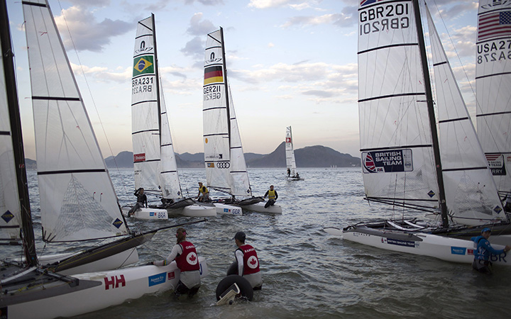 Athletes from the Nacra 17 Mixed Multihull class return to Flamengo beach after competing in a sailing test event for the Rio 2016 Olympic Games in Guanabara Bay, Rio de Janeiro, Brazil, Wednesday, Aug. 19, 2015.