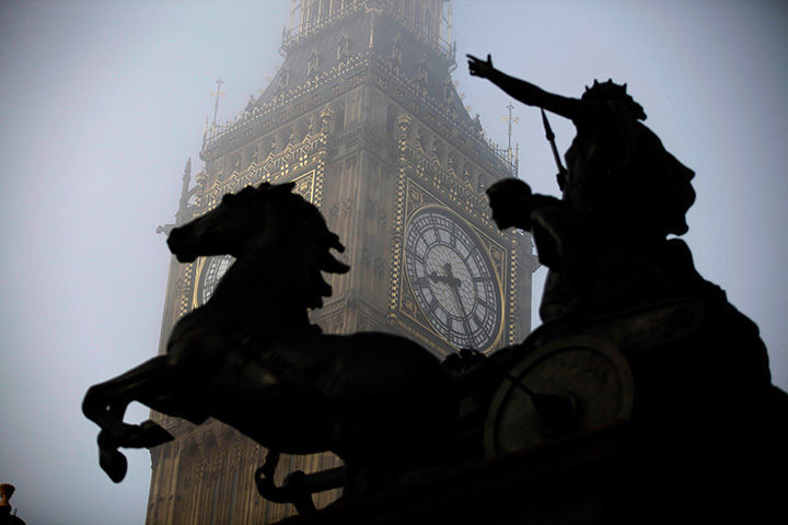 The Boudicca statue stands in the foreground as fog shrouds the clock tower which houses the Big Ben bell at the Palace of Westminster, London.